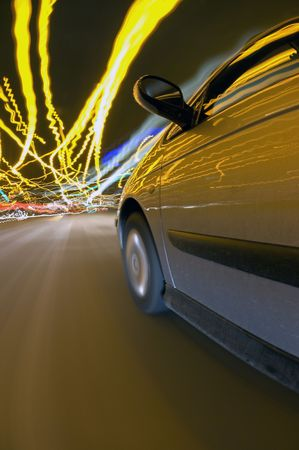 A car finding its way through the downtown traffic amidst the clutter of lights photo