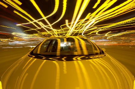 frantic: A car driving through the frantic traffic of a busy city during rush hour (Quadruple exposure)