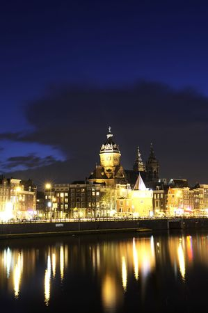The beautifully lit monumental buildings in Amsterdam city Center at night Stock Photo - 2953984