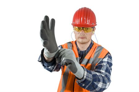 A worker, demonstratively putting on his safety gloves. Clipping path included