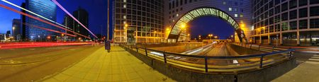 a 360 degrees panoramic image of a roundabout on top of a motorway. A big downtown junction photo