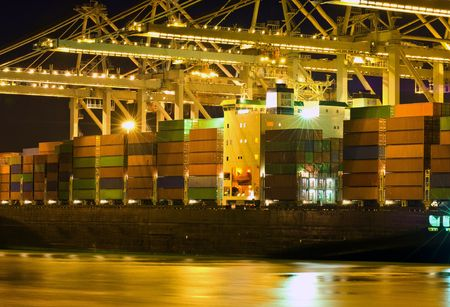 seafreight: Close up of a container ship being unloaded Stock Photo