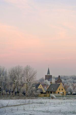 The winter dawn on small rural village of Ellewoutsdijk, Zeeland (Zuid-Beveland) the Netherlands Stock Photo - 3297870