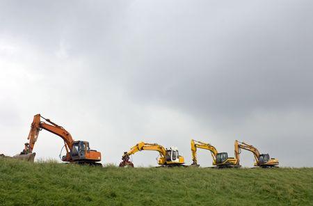 tortillera: Cuatro mineros sobre un dique en Zeeland, Pa�ses Bajos