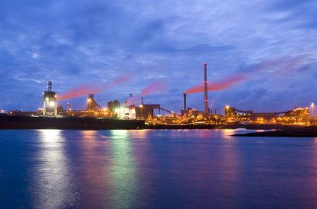 frontend: The front-end of a steel plant, with a bulk carrier with iron ore being unloaded
