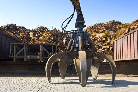 gripper: A huge mechanical claw, used to manipulate steel scrap on a scrapheap Stock Photo