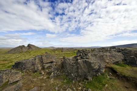 erratic: Erratic lava formations across the tundra over the volcanic mountain range the Kerlingafjoll in Hveravellir; an area on the atlantic ridge, separating the Eurasian plate form the North American plate