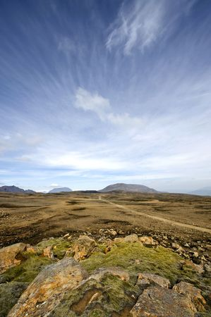 The table mountains and the volcanoes of the Katla System in Iceland, with the empty barren lava fields in the Middalsfjall region photo