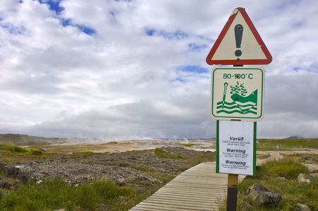 hydroxide: Warning sign for Geothermal activity and boiling water erupting from the earth in the Hveravellir Hot Spring area in Iceland Stock Photo