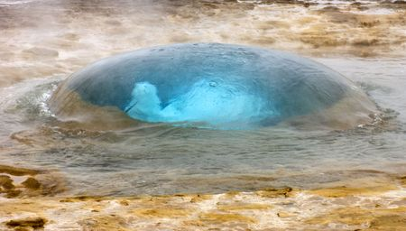 blow hole: The famous Strokkur Geyser about to erupt Stock Photo