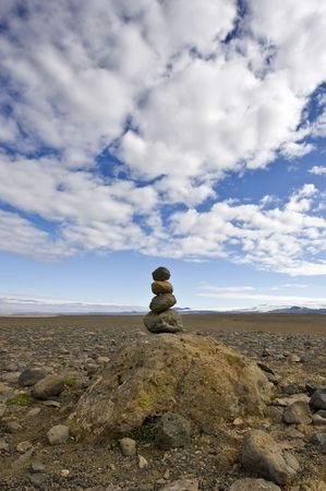 omen: A Varda is an Icelandic custom and an omen for a safe onward journey. For some, it represents Zen, for others, the stack of stone is merely a road side marker Stock Photo
