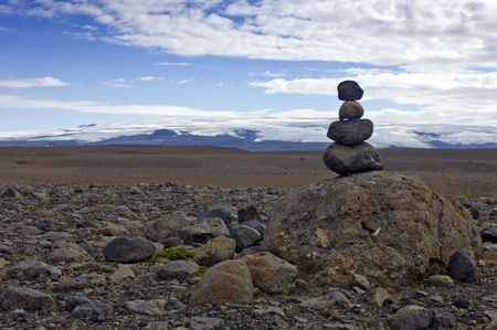 volcanic stones: A Varda - or stone man - symbolising a safe onward journey, is often encountered in the rough Icelandic interior. To some its just a stack of rocks, to others the perfect balance amongst the volcanic stones represents Zen