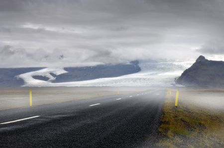 saga: The mystical feel of the road towards the Skaftafel National Park, with a view on the clearly lit Vatnajokull glaciers runners, the Skaftafellsjokull and the Svinafellsjokull
