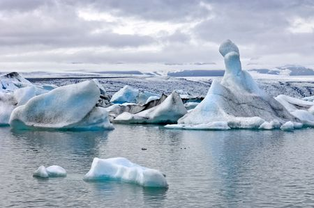 The famous Jokulsarlon glacier lake in Iceland, where the icebergs, originating from the Vatnajokull float. This location was used for various action movies. photo