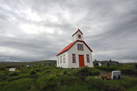saga: According to Icelandic tradition, Christianity and the belief in the Saga go hand in hand; the wooden churches, surrounded by graves, together with the gloomy weather sketch this feeling of religion