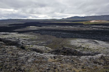 hydroxide: The black lava streams, resulting from the 1984 eruption of the Krafla Volcanic System in Iceland is still warm, and provides the proof of the forces of nature