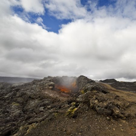 fissures: The hot, scorched earth of the Krafla volcanic system, with its extensive lava fields, fissures and explosion craters Stock Photo