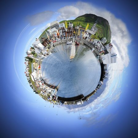 Living in your own world makes life simple and pleasant. A spherised manipulation of a panoramic stitch from 34 images of the arctic fishing village of Husavik, Iceland photo