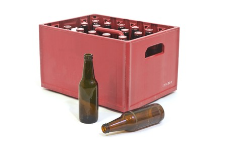 Red Beer crate with two empty bottles in front photo