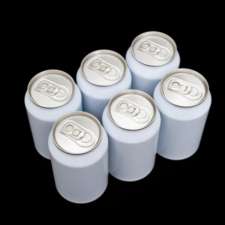 unprinted: A six pack of unprinted beverage cans on a black background