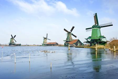 Four typically Dutch windmills in De Zaanse Schans near de river Zaan in the Netherlands Stock Photo - 4093299