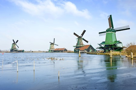 archetypal: Four typically Dutch windmills in De Zaanse Schans near de river Zaan in the Netherlands Stock Photo