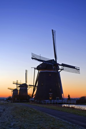 leidschendam: The three monumental windmills at Leidschendam, the Netherlands, neatly aligned on a beautiful winter dawn Stock Photo