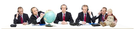 businessman waiting call: A single persons call center of a self employed businessman answering various questions by telephone. A conceptual image of being flexible, multitasking and service oriented