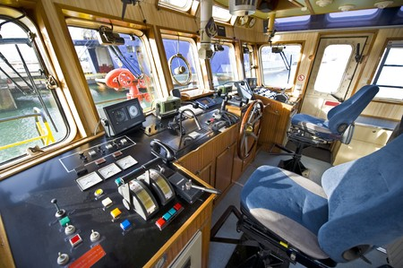 levers: The wheelhouse of a fireboat with various navigational equipment Stock Photo