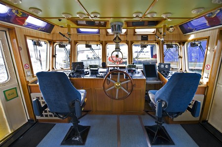The wheelhouse of a fireboat with various navigational equipment photo