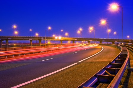 flyover: Cars breaking on an overpass of a motorway at night Stock Photo