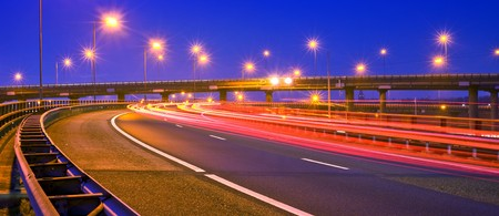 overpass: Cars breaking on an overpass of a motorway at night Stock Photo
