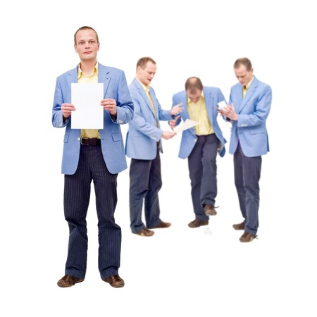 worthless: A man, proudly showing his work on a sheet of paper, whereas in the back of his mind, he knows what he produced is worthless Stock Photo