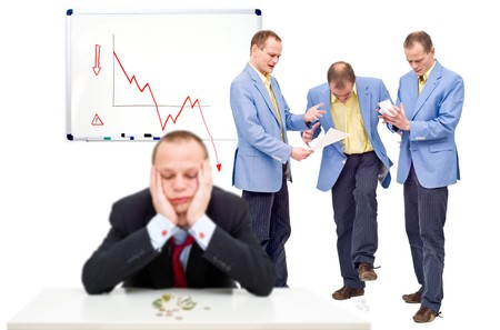 Three unhappy employees, angry at their indecicive boss, in front of a whiteboard showing a negative graph, representing the state of a business in financial crisis photo
