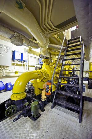 The engine room of a tugboat with its huge diesel engines Stock Photo - 4264546