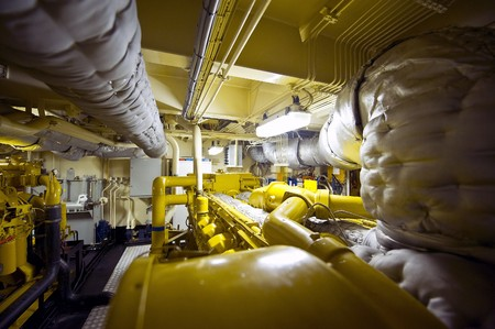 vents: The engine room of a tugboat with valves, vents, exhaust, pipes and plumbing
