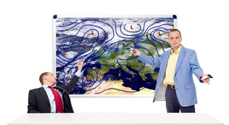 high pressure: Two weathermen behind an anchor desk showing the weather forecast