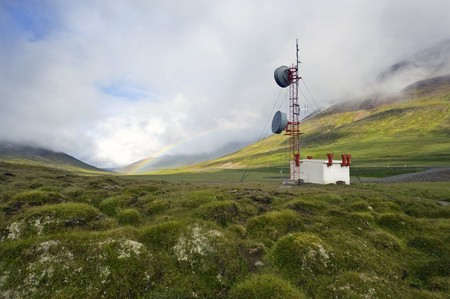 A communications tower in the Tundra of Iceland with a rainbow in the background Stock Photo - 4541684