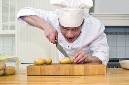 crazed: A chef with a crazed look in his eyes, agressively slicing potatoes
