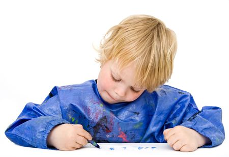 concentrating: Young boy concentrating on his drawing Stock Photo