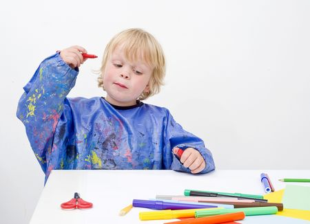 commencing: Young child getting an idea, ready to start his drawing