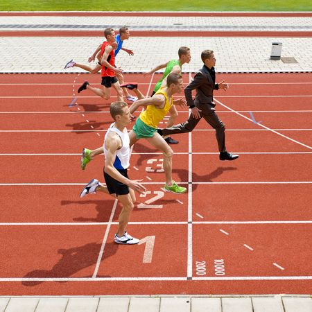 Business metaphore of staying ahead, winning in business,business competition, and continuous improvement, represented by a photo finish of a track race Stock Photo - 4983442