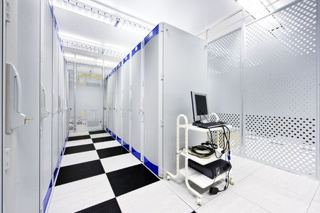Clean suite in a data center with the perforated doors of server racks and a computer cart photo