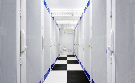 Clean suite in a data center with the perforated doors of server racks photo