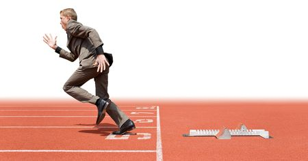 Businessman leaving the starting blocks - a metaphor of starting a new business, off on a good start photo