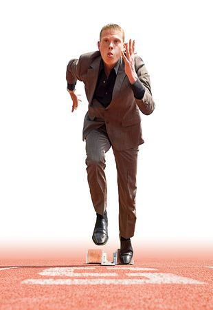 Businessman leaving the starting blocks - a metaphor of starting a new business Stock Photo