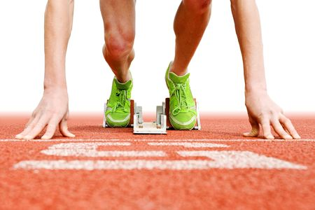 running on track: Athlete in the starting blocks, ready to go Stock Photo