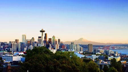 Panoramic view of Seattle with Mt. Rainier visible in the background. Horizontally framed shot.