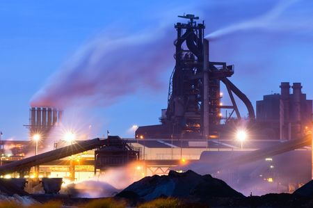 Heavy industry at night with a blast furnace dominating the scene photo
