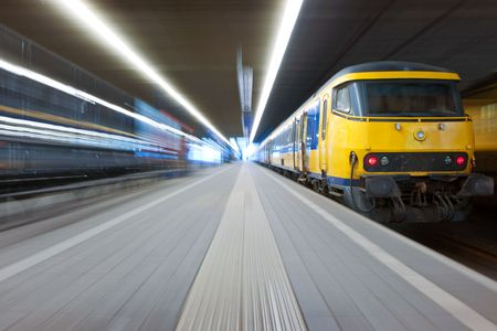 Trying to catch a departing train from a platform at a train station